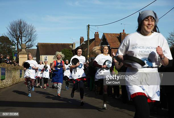 Competitors take part in the annual Shrove Tuesday transAtlantic pancake race on February 9 2016 in Olney England On Shrove Tuesday every year the...