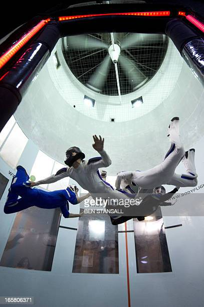 Competitors take part in the BodyFlight World Challenge indoor skydiving championships in Bedford East England on April 5 2013 During the two day...