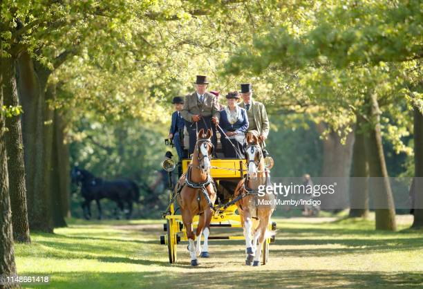 Competitors take part in 'The Champagne Laurent-Perrier Meet of the British Driving Society' on day 5 of the Royal Windsor Horse Show in Home Park on...
