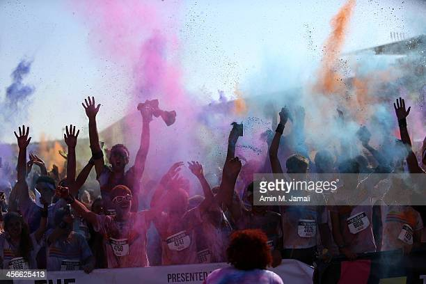 Competitors take part in The Color Run presented by Activelife by Daman on December 14 in Dubai United Arab Emirates