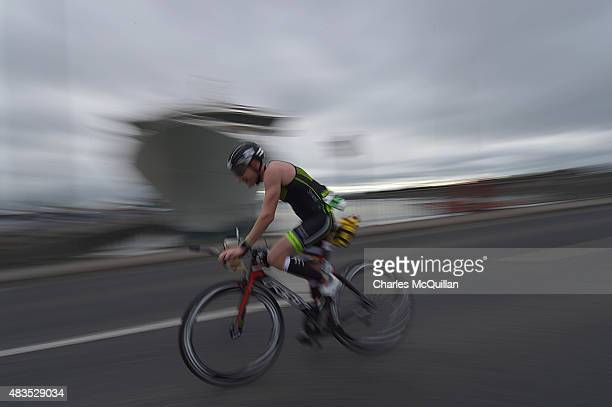 Competitors take part in the cycling section during the Ironman triathlon event on August 9 2015 in Dublin Ireland More than 2500 athletes swim cycle...