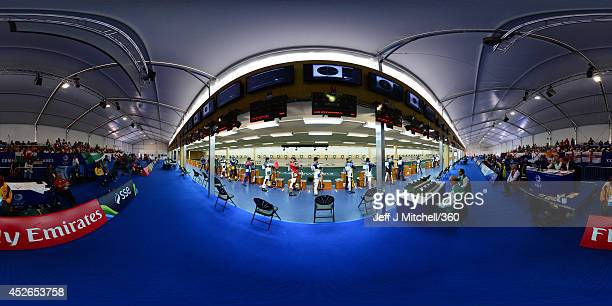 Competitors take part in the men's 10m air rifle at Barry Buddon Shooting Centre during day two of the Glasgow 2014 Commonwealth Games on July 25,...