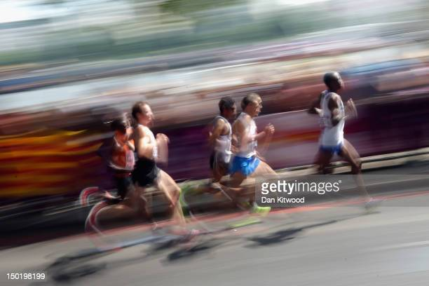 Competitors take part in the men's Marathon during Day 16 of the London 2012 Olympic Games on August 12 2012 in London England