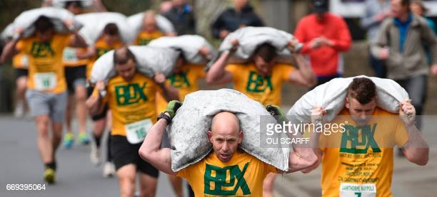 Competitors take part in the Men's Race at the annual World Coal Carrying Championships in the village of Gawthorpe near Wakefield northern England...