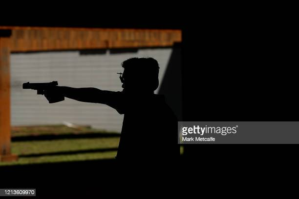Competitors take part in the Men's Rapid Fire Pistol event during the Australia Olympic Games Pistol & Shotgun Nomination Trials at SISC on March 20,...