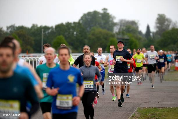 Competitors take part in the non socially-distanced Reunion 5K running race, one of the pilot events in the governments Events Research Programme at...