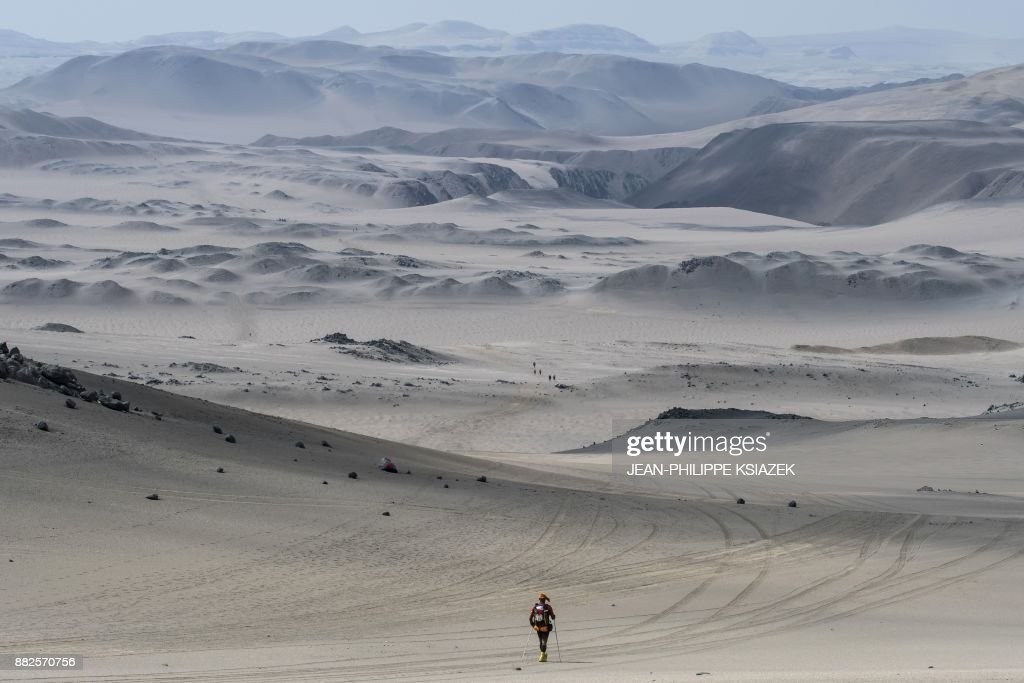 TOPSHOT - Competitors take part in the second stage of the first edition of the Marathon des Sables Peru between Coyungo and Samaca in the Ica Desert on November 29, 2017. Competitors compete in the race of approximately 250 kms, which is divided into six stages through the Ica Desert at a free pace and in self-sufficiency conditions from November 28 to December 4, 2017. /