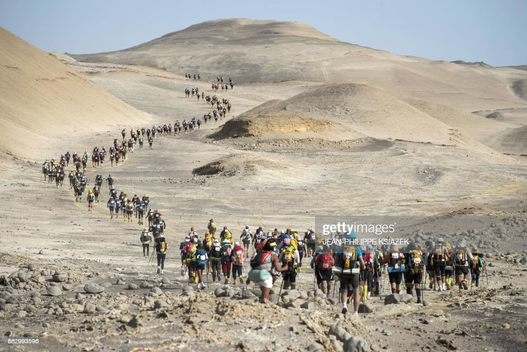 TOPSHOT - Competitors take part in the third stage during the first edition of the Marathon des Sables Peru, between Samaca and Ocucaje, in the Ica desert, on November 30, 2017. Competitors compete in the race of approximately 250 kms, which is divided into six stages through the Ica Desert at a free pace and in self-sufficiency conditions from November 28 to December 4, 2017. /