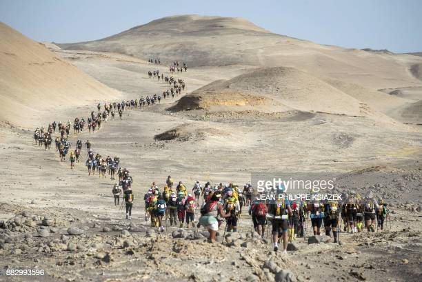 TOPSHOT Competitors take part in the third stage during the first edition of the Marathon des Sables Peru between Samaca and Ocucaje in the Ica...