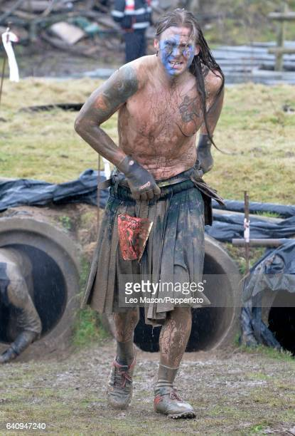 Competitors take part in The Tough Guy Challenge at South Perton Farm on January 29 2017 in Telford England