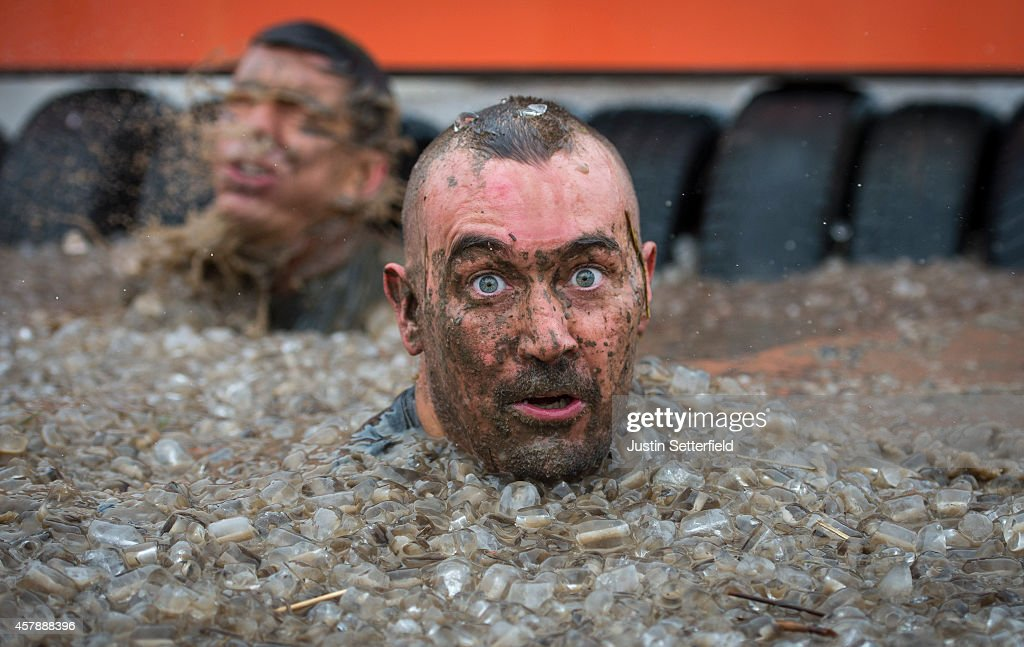 Competitors take part in the Tough Mudder London South on October 25, 2014 in Winchester, England. The world-famous Tough Mudder is military style endurance event over 10-12 mile obstacle course designed to test all-around strength, stamina, teamwork, and mental grit.