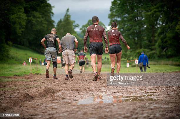 Competitors take part in the Tough Mudder Scotland at Drumlanrig Castle on June 21 2015 in Thornhill England Tough Mudder is a 1012 mile...