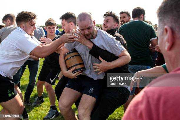 Competitors take part in the traditional Easter Monday 'Bottle Kicking' match on April 22 2019 in Hallaton England The Bottle Kicking event has two...
