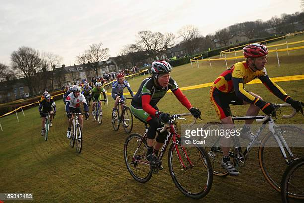 Competitors take part in the 'Veteran Men 50' category race at the 2013 National CycloCross Championships in Peel Park on January 12 2013 in Bradford...