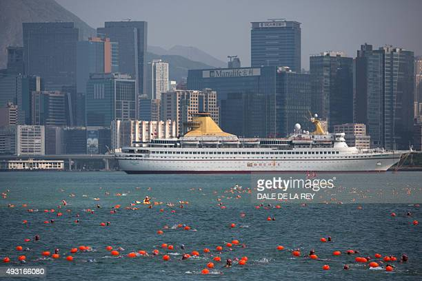 Competitors take part in the Victoria Harbour swimming race in Hong Kong on October 18 2015 Swimmers braved Hong Kong waters on October 18 to compete...