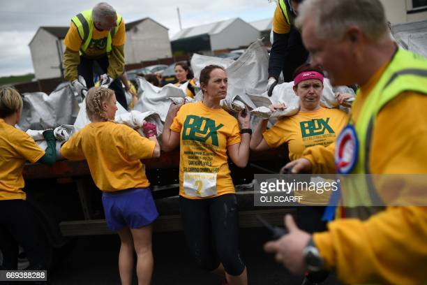 Competitors take part in the Women's Race at the annual World Coal Carrying Championships in the village of Gawthorpe near Wakefield northern England...