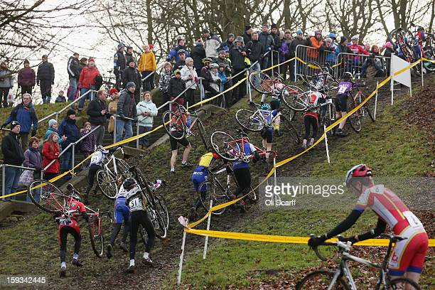 Competitors take part in the 'Youth Under 14' category race at the 2013 National CycloCross Championships in Peel Park on January 12 2013 in Bradford...