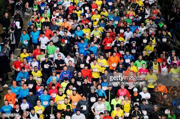 Competitors take the start of the 21st edition of the Paris Half-Marathon on March 3, 2013 in Paris. AFP PHOTO / LIONEL BONAVENTURE