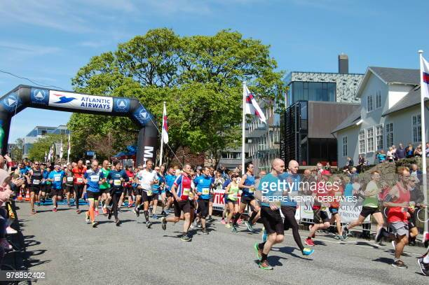 Competitors take the start of the Atlantic Airways Tórshavn Marathon on June 3 2018 in the city of Torshavn on the Streymoy Island the largest of...