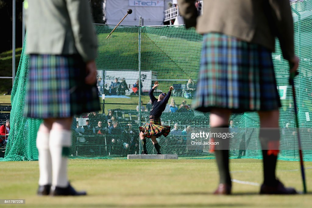 Competitors throw a weight during the 2017 Braemar Gathering at The Princess Royal and Duke of Fife Memorial Park on September 2, 2017 in Braemar, Scotland.