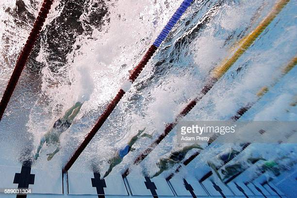 Competitors touch the wall in the Men's 50m Freestyle Final on Day 7 of the Rio 2016 Olympic Games at the Olympic Aquatics Stadium on August 12 2016...