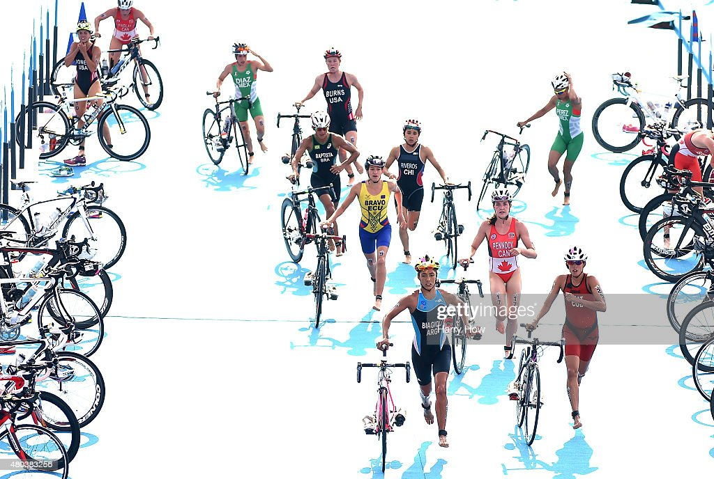 Competitors transition to bikes in the women's triathlon at