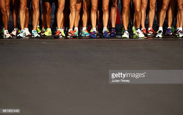 Competitors wait at the start line for the Men's 50km Race Walk on Day 14 of the Rio 2016 Olympic Games at Pontal on August 19 2016 in Rio de Janeiro...