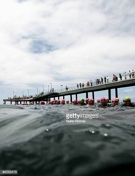 Competitors wait to start of the swim during the Lorne Pier To Pub open water swim at Louttit Bay January 10 2009 in Lorne Australia The Lorne Pier...