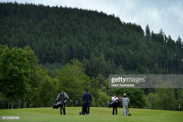 Competitors walk to the 10th green during the Lombard Trophy Scottish Qualifier at Crieff Golf Club on July 10 2017 in Crieff Scotland