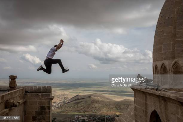 A competitor looks over the course ahead of the start of the Speed category during the second round of the World Parkour Championships on May 12 2018...