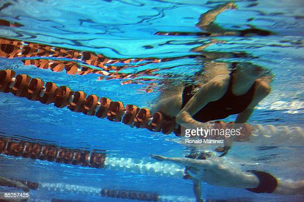Competitors warm up during day one of the 2009 USA Swimming Austin Grand Prix on March 5 2009 at the Lee and Joe Jamail Texas Swimming Center in...