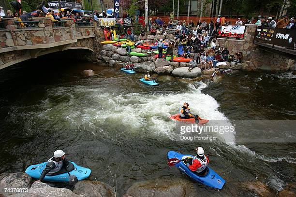 Competitors warm up during the Kayak Pro Freestyle Qualifier in Whitewater Park on Gore Creek during The Teva Mountain Games on June 1, 2007 in Vail,...