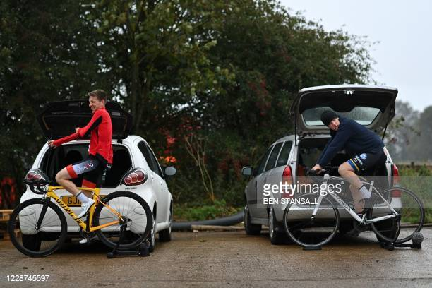 Competitors warm up on trainers as they prepare to compete in the 44th Wigmore CC Hollingbourne Hill Climb, on the north downs in south-east England...