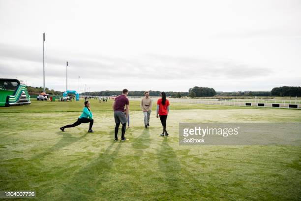 competitors warming up before outdoor event - sports event stock pictures, royalty-free photos & images