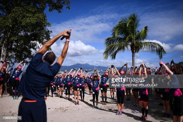 Competitors warmup prior to the kayak race during the Raid des Alizes an exclusively allfemale multi sport competition on the French Caribbean island...