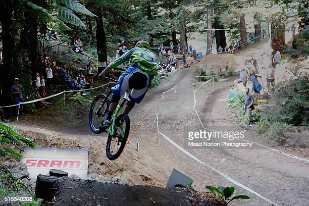 A competor jumping over the Hip Replacement jump during the Downhill race at Crankworx Rotorua on March 13 2016 in Rotorua New Zealand