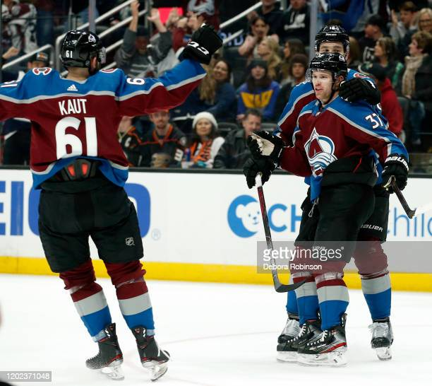 T Compher and Martin Kaut of the Colorado Avalanche celebrate Compher's second period goal during the game against the Anaheim Ducks at Honda Center...