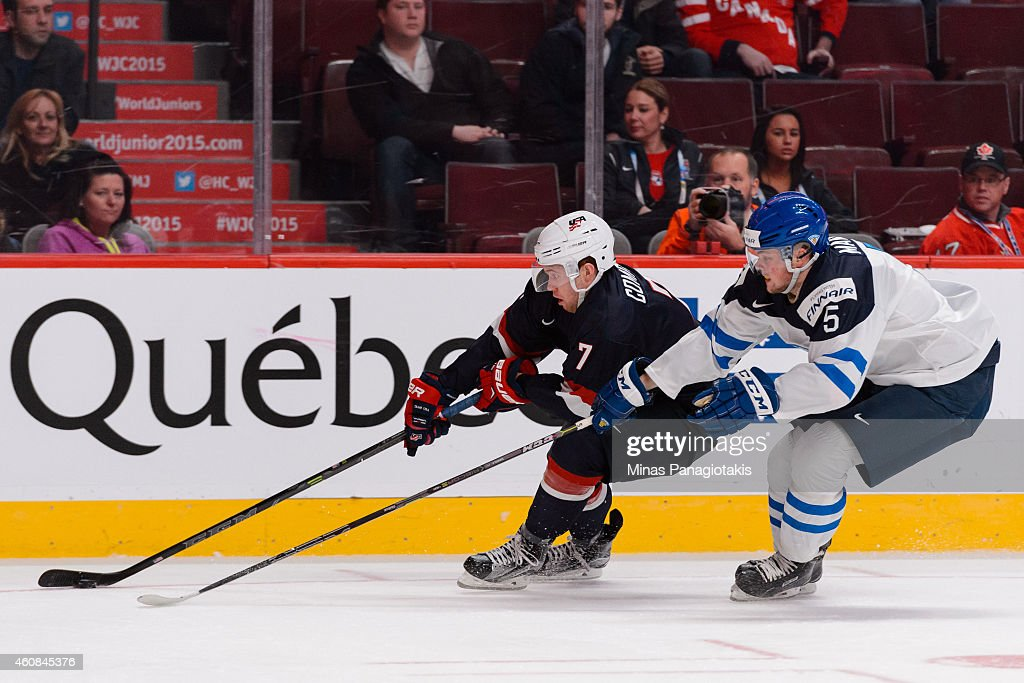 JT Compher #7 of Team United States tries to play the puck with Aleksi Makela #5 of Team Finland following during the 2015 IIHF World Junior Hockey Championship game at the Bell Centre on December 26, 2014 in Montreal, Quebec, Canada. Team United States defeated Team Finland 2-1 in a shootout.