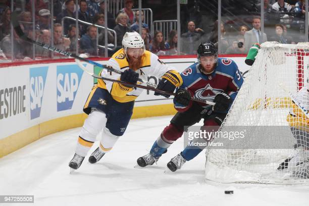 T Compher of the Colorado Avalanche battles for position against Ryan Ellis of the Nashville Predators in Game Three of the Western Conference First...
