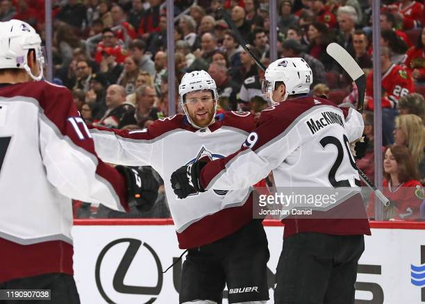 T Compher of the Colorado Avalanche celebrates a first period goal with Tyson Jost and Nathan MacKinnon against the Chicago Blackhawks at the United...
