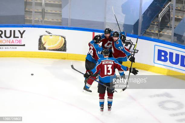 T Compher of the Colorado Avalanche celebrates with his teammates after scoring a goal on Darcy Kuemper of the Arizona Coyotes during the third...