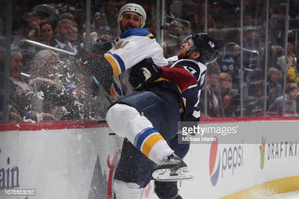 T Compher of the Colorado Avalanche hits Robert Bortuzzo of the St Louis Blues at the Pepsi Center on November 30 2018 in Denver Colorado