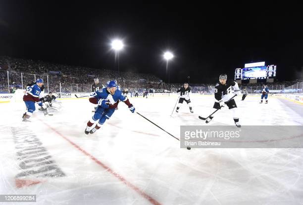 Compher of the Colorado Avalanche reaches for the puck during the second period of the 2020 NHL Stadium Series game against the Los Angeles Kings at...