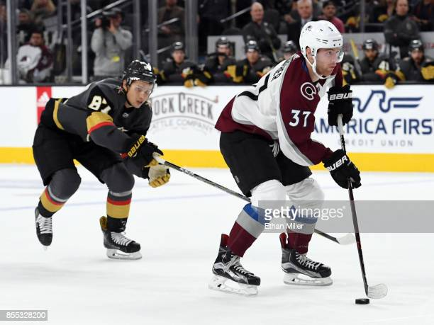 T Compher of the Colorado Avalanche skates under pressure from Vadim Shipachyov of the Vegas Golden Knights during their preseason game at TMobile...