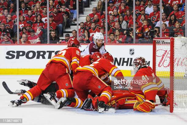 Compher of the Colorado Avalanche takes a shot on Mike Smith of the Calgary Flames in Game Five of the Western Conference First Round during the 2019...