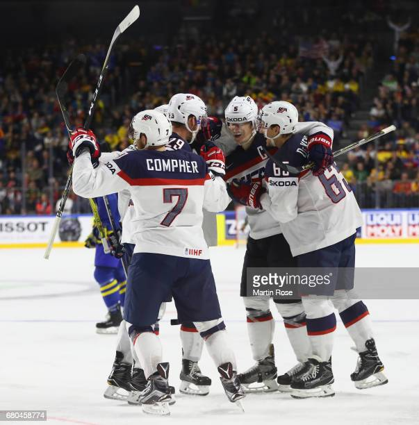 T Compher of USA celebrates scoring the fourth goal with teamates during the 2017 IIHF Ice Hockey World Championship game between USA and Sweden at...