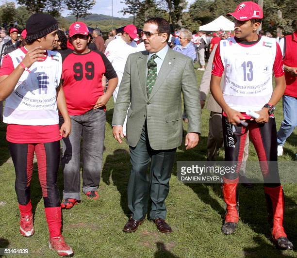 Bahrain's King skeik Hamad Bin Isa Al Khalifa chats with his tree sons, Khalid , Fassal and Nasser 26 August 2005 during the Open European Endurance...