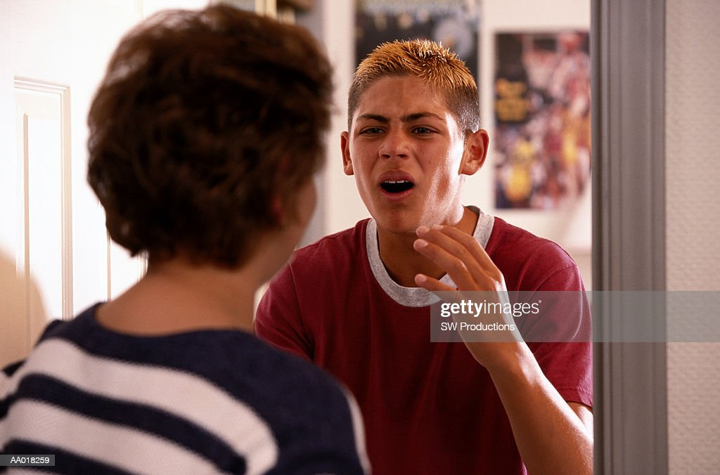 Complaining Mother Talking to Teenaged Son : Stock Photo
