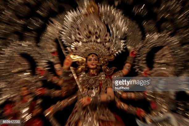 A complete Durga idol is seen at a temporary makeshift as it decorated in the Silver ornaments ahead of the goddess Durga Puja festival in the...