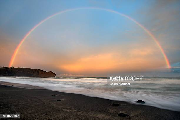 complete rainbow at sunset on beach - cap d'agde stock photos and pictures